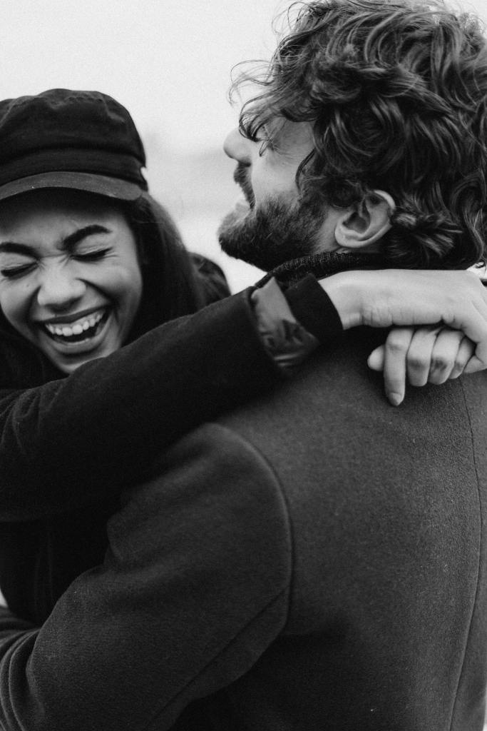 This image has an empty alt attribute; its file name is monochrome-photo-of-couple-laughing-3692738.jpg
